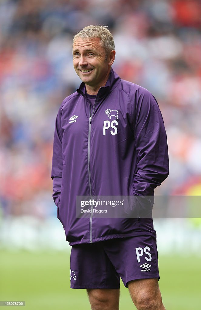 Paul Simpson, the Derby County first team coach looks on during the pre season friendly match between Derby County and Rangers at iPro Stadium on August 2, 2014 in Derby, England.