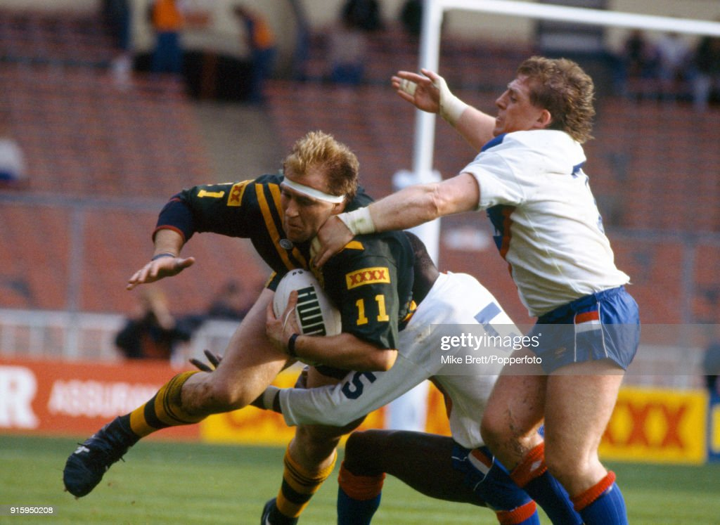 Paul Sironen of Australia (with the ball) is tackled by Andy Gregory (right) and Roy Powell (5) of Great Britain during their International rugby league match at Wembley Stadium in London on 27th October 1990. Great Britain won 19-12.