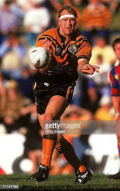 Paul Sironen of the Tigers offloads the ball during a ARL match between the Balmain Tigers and the Newcastle Knights at Leichhardt Oval in Sydney,...