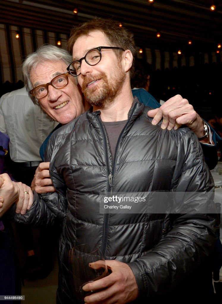 Paul Smith (L) and Sam Rockwell, wearing Paul Smith, attend Paul Smith's intimate dinner with Gary Oldman at Chateau Marmont on April 10, 2018 in Los Angeles, California.