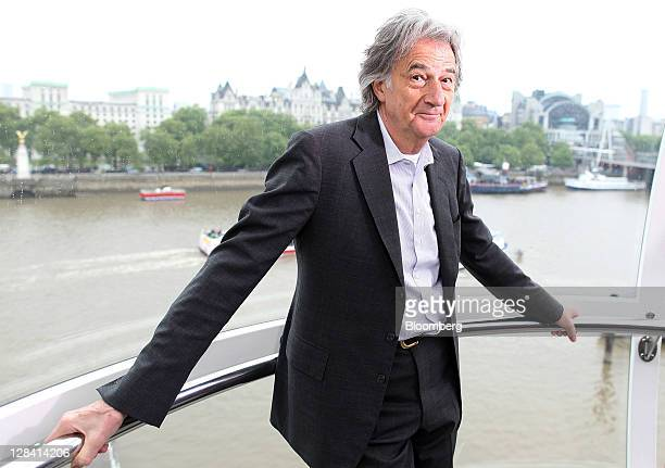 Paul Smith British designer and founder of Paul Smith Ltd poses for a photograph during a Bloomberg Television interview on the EDF Energy London Eye...