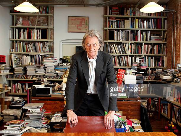 Paul Smith British designer and founder of Paul Smith Ltd poses for a photograph in his office during a Bloomberg Television in London UK on Thursday...