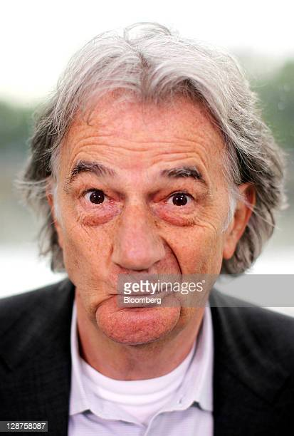 Paul Smith British designer and founder of Paul Smith Ltd reacts as he poses for a photograph during a Bloomberg Television interview on the EDF...