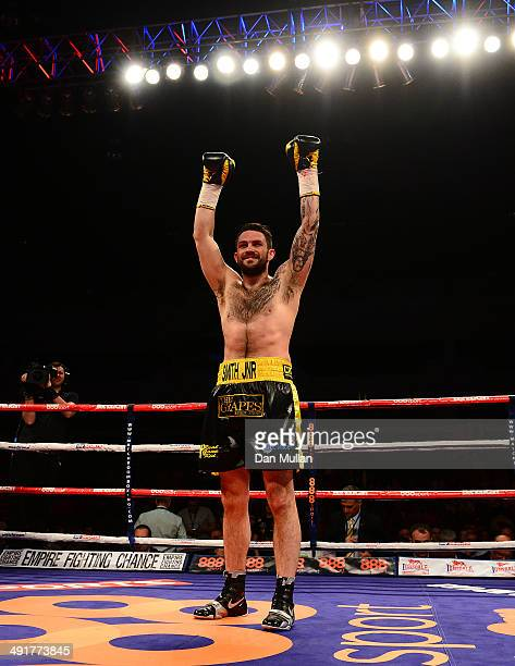Paul Smith celebrates after defeating David Sarabia following their Super Middleweight bout at the Motorpoint Arena on May 17 2014 in Cardiff Wales