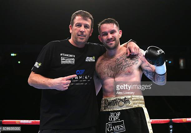Paul Smith celebrates with trainer Joe Gallagher after knocking down Bronislav Kubin to win the SuperMiddleweight Contest between Paul Smith and...