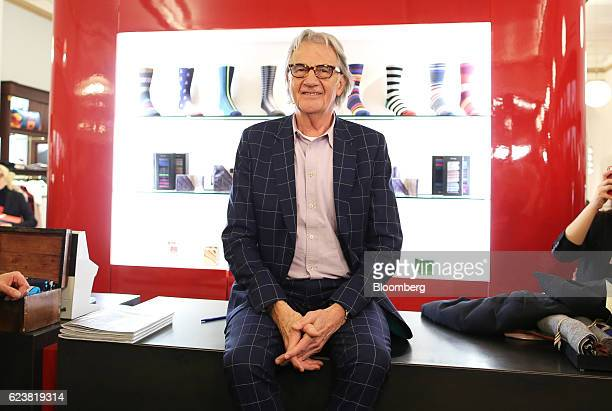 Paul Smith chairman of Paul Smith Ltd poses for a photograph inside the Paul Smith Ltd boutique at the GUM department store on Red Square in Moscow...