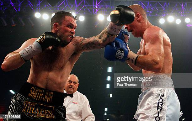 Paul Smith in action with Tony Dodson during the British Super Middleweight championship fight at Bolton Arena on June 29 2013 in Bolton England