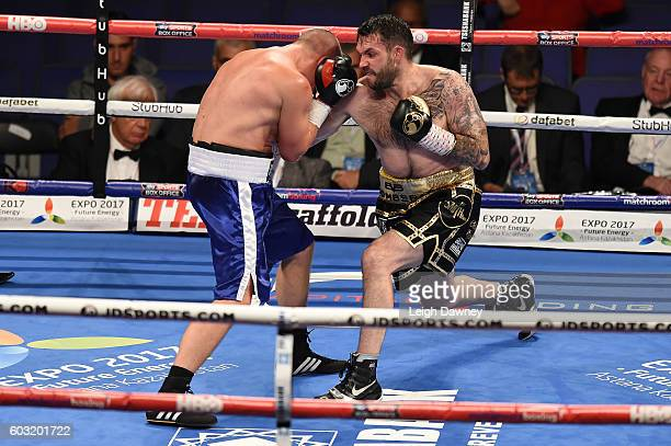 Paul Smith lands a punch on Daniel Regi in a Light heavyweight contest at The O2 Arena on September 10 2016 in London England