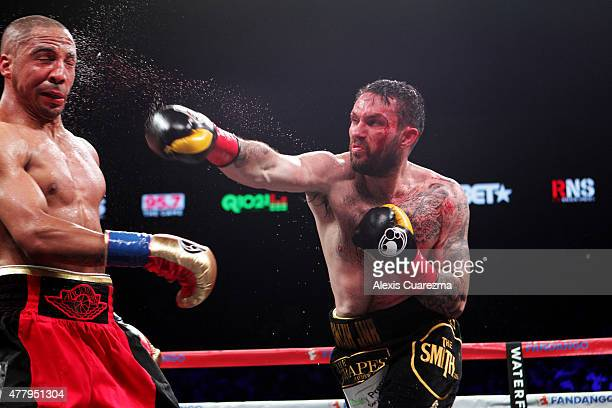 Paul Smith lands a right on Andre Ward during their Cruiserweight fight at ORACLE Arena on June 20 2015 in Oakland California