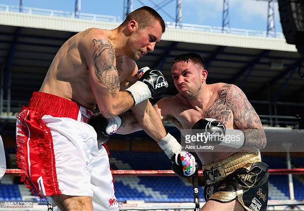 Paul Smith lands a right shot on Bartlomiej Grafka during the SuperMiddleweight Contest between Paul Smith and Bartlomiej Grafka at Goodison Park on...