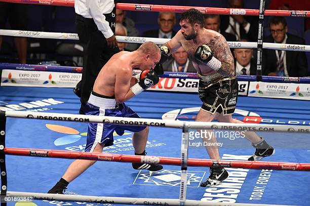 Paul Smith trades punches with with Daniel Regi during a Light heavyweight contest at The O2 Arena on September 10 2016 in London England