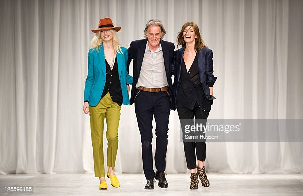 Paul Smith walks the catwalk with models during the Paul Smith LFW Spring/Summer 2012 show at the Royal Horticultural Society on September 18 2011 in...