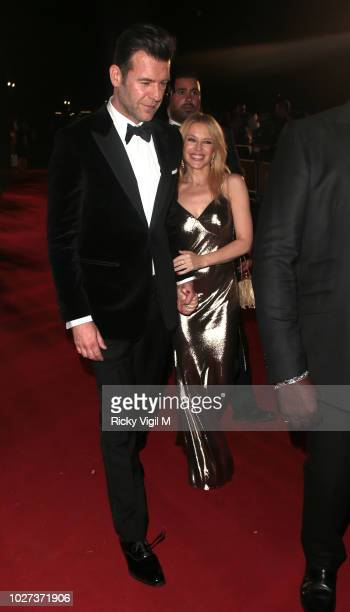 Paul Solomons and Kylie Minogue seen leaving GQ Men of the Year Awards held at Tate Modern on September 5 2018 in London England