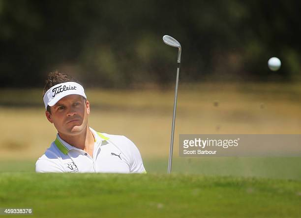 Paul Spargo of Australia plays a shot out of a bunker on the 7th hole during day two of the Australian Masters at The Metropolitan Golf Course on...