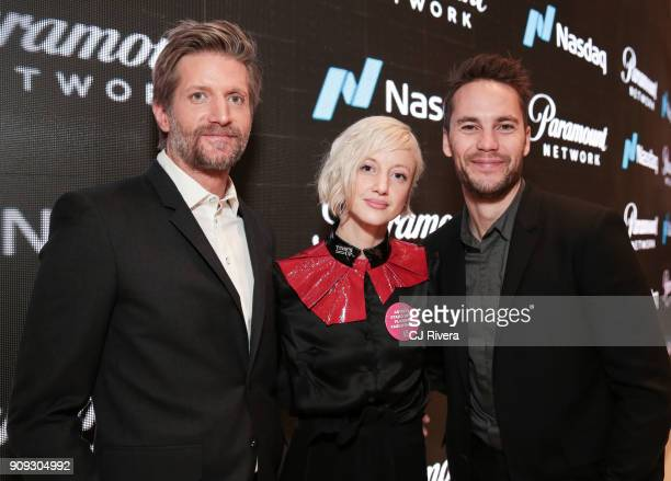 Paul Sparks Andrea Riseborough and Taylor Kitsch attend the Paramount Network and the cast of 'Waco' ring the Nasdaq Opening Bell at NASDAQ...