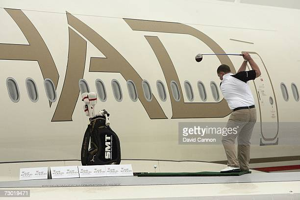 Paul 'St George' Slater of England attempts a new world long driving record from the wing of a Etihad Airways Airbus A340 during the 'Etihad Airways...