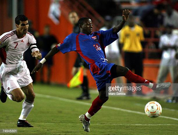 Paul Stalteri of Canada chases J Michel Alexandre Boucicaut of Haiti during the first half during the CONCACAF Gold Cup First Round June 11 2007 at...