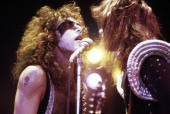 Paul stanley and ace frehley of us rock band kiss singing into a on picture id117976867?s=170x170