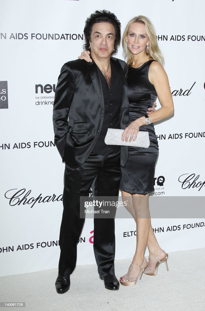 Paul Stanley (L) and Erin Sutton arrive at the 20th Annual Elton John AIDS Foundation Academy Awards viewing party held across the street from the Pacific Design Center on February 26, 2012 in West Hollywood, California.