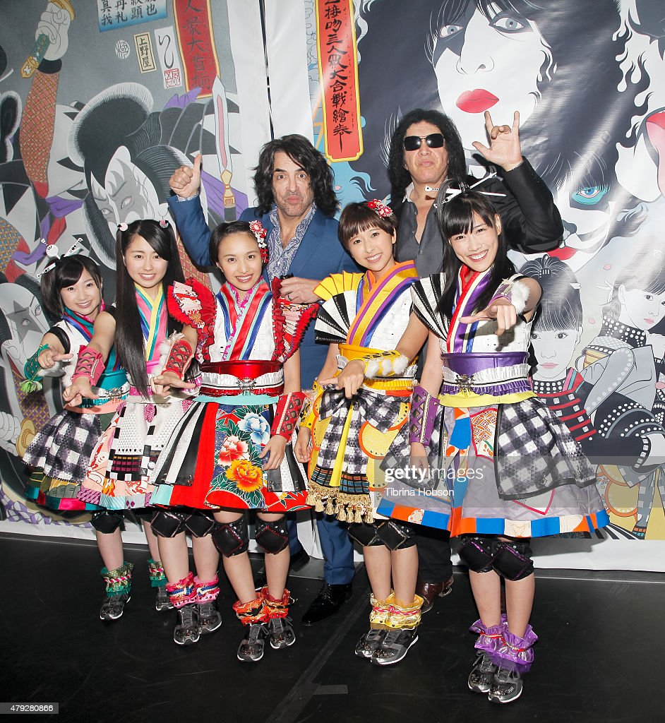 Paul Stanley and Gene Simmons of KISS and (front row L-R) Momoka Ariyasu, Ayaka Sasaki, Kanako Momota, Shiori Tamai and Reni Takagi of MCZ attend the KISS press conference introducing Japanese Band Momoiro Clover Z (MCZ) at Microsoft Theater on July 2, 2015 in Los Angeles, California.