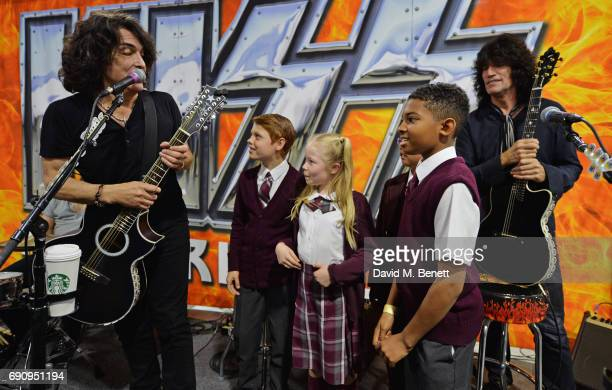 Paul Stanley and Tommy Thayer of KISS meet 'School Of Rock The Musical' cast members Toby Lee Eliza Cowdery Cole Lam and Bailey Cassell during an...