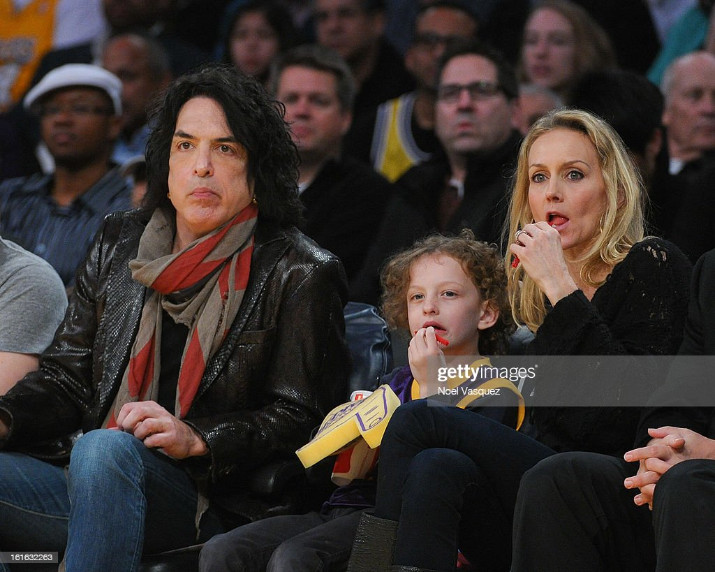 Paul Stanley, his son Colin and his wife Erin Sutton attend a basketball game between the Phoenix Suns and the Los Angeles Lakers at Staples Center on February 12, 2013 in Los Angeles, California.