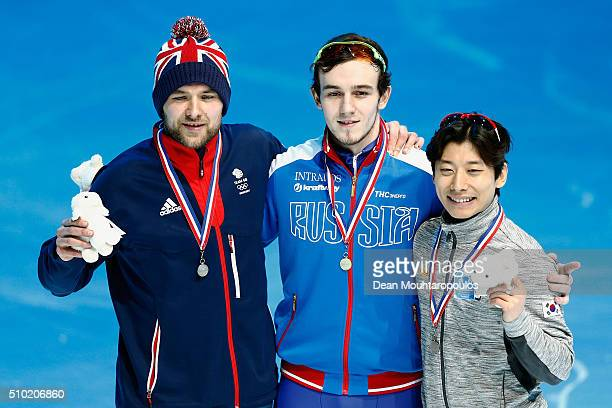 Paul Stanley of Great Britain Dmitry Migunov of Russia and YoonGy Kwak of South Korea pose after the 500m Mens Final during ISU Short Track Speed...