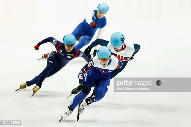 Paul Stanley of Great Britain Dmitry Migunov of Russia and YoonGy Kwak of South Korea compete in the 500m Mens Final during ISU Short Track Speed...