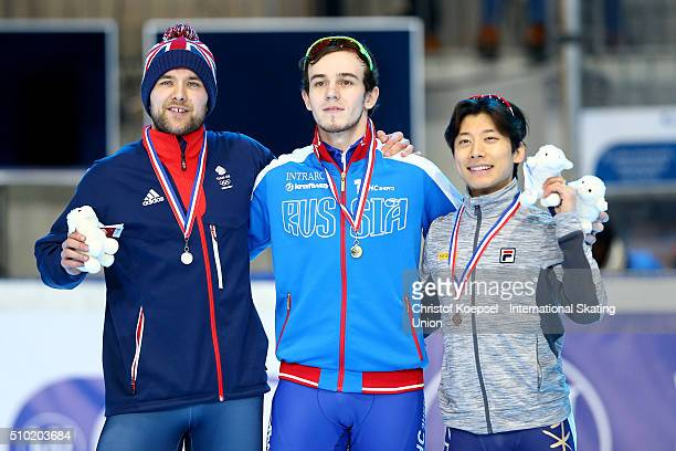 Paul Stanley of Great Britain poses during the medal ceremony after winning the 2nd place Dmitry Migunov of Russia poses during the medal ceremony...
