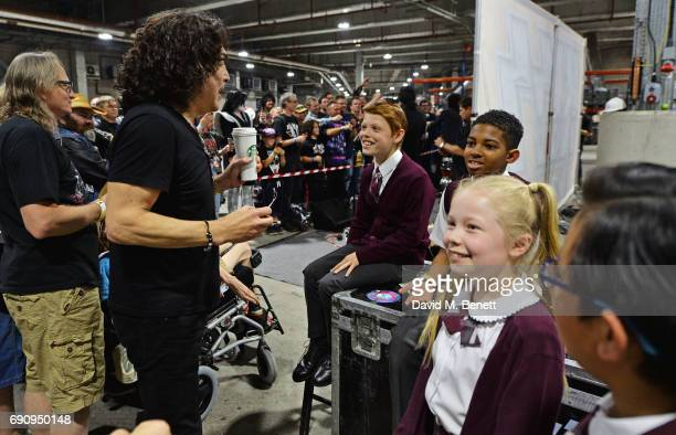 Paul Stanley of KISS meets 'School Of Rock The Musical' cast members Toby Lee Bailey Cassell Eliza Cowdery Cole Lam during an acoustic performance...