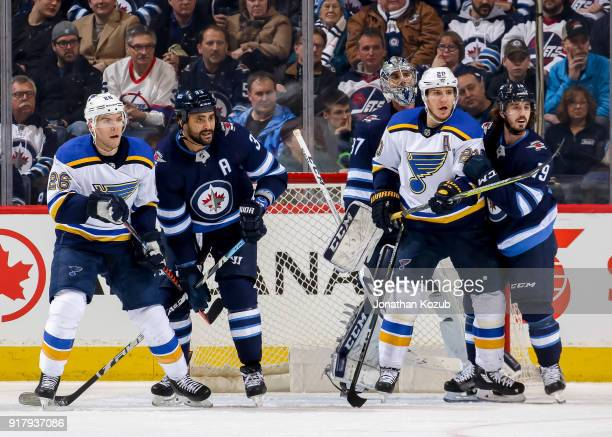 Paul Stastny and Alexander Steen of the St Louis Blues battle for position against Dustin Byfuglien and Nic Petan of the Winnipeg Jets in front of...