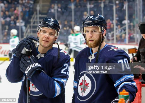Paul Stastny and Joe Morrow of the Winnipeg Jets look on during the pregame warm up prior to NHL action against the Dallas Stars at the Bell MTS...