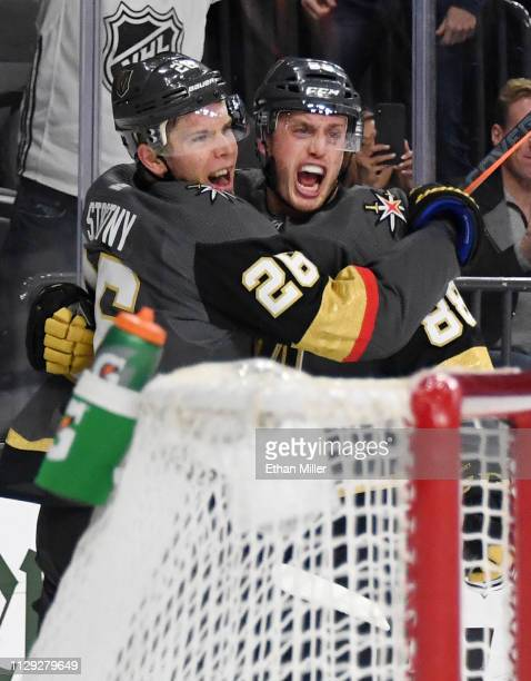 Paul Stastny and Nate Schmidt of the Vegas Golden Knights celebrate after Stastny assisted Schmidt on a secondperiod goal against the Arizona Coyotes...