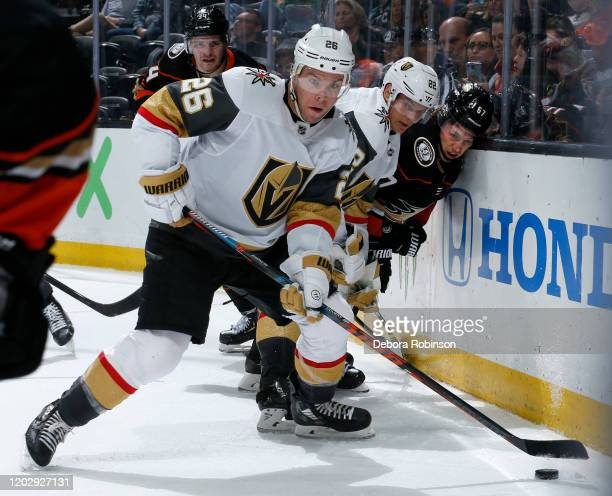Paul Stastny and Nick Holden of the Vegas Golden Knights battle for the puck against Rickard Rakell of the Anaheim Ducks during the game at Honda...