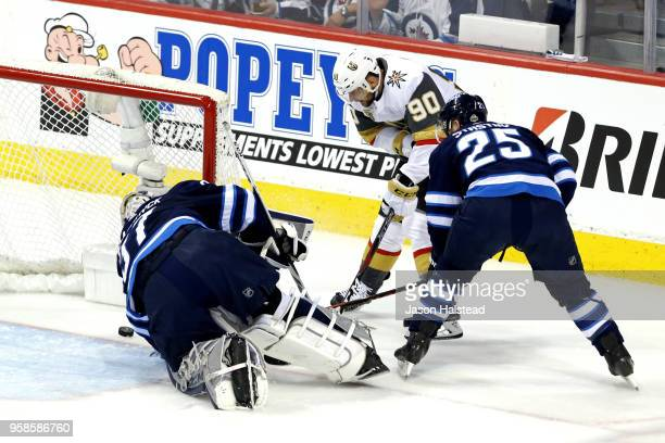 Paul Stastny defends as teammate Connor Hellebuyck of the Winnipeg Jets allows a first period goal to Tomas Tatar of the Vegas Golden Knights in Game...