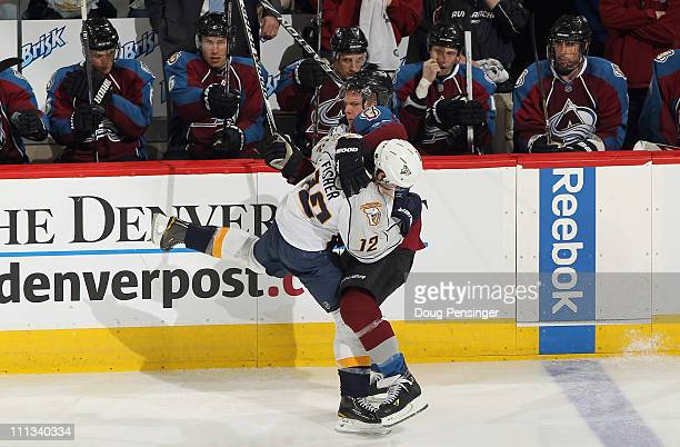 Paul Stastny of the Colorado Avalanche and Mike Fisher of the Nashville Predators get tangled up at the Pepsi Center on March 31 2011 in Denver...