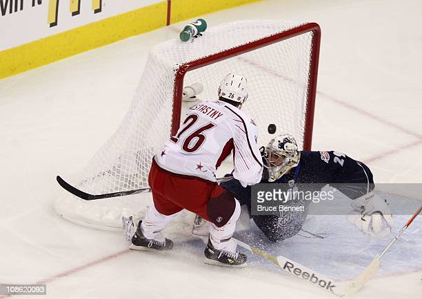 Paul Stastny of the Colorado Avalanche and Team Staal scores a first period goal on MarcAndre Fleury of the Pittsburgh Penguins and Team Lidstrom in...
