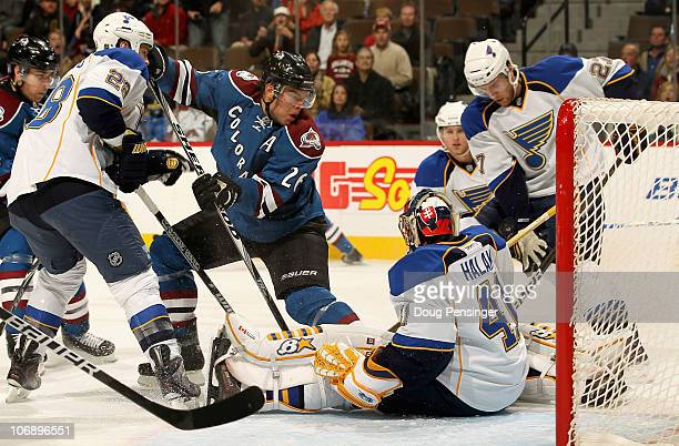 Paul Stastny of the Colorado Avalanche collects a rebound and puts the puck in the goal past goalie Jaroslav Halak and defenseman Alex Pietrangelo of...