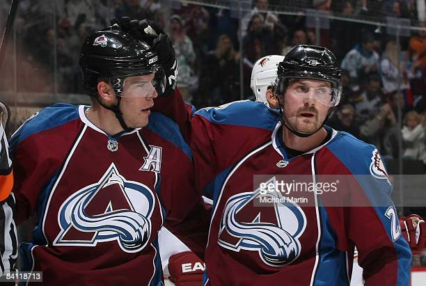 Paul Stastny of the Colorado Avalanche is congratulated by teammate Milan Hejduk after scoring a goal against the Phoenix Coyotes at the Pepsi Center...