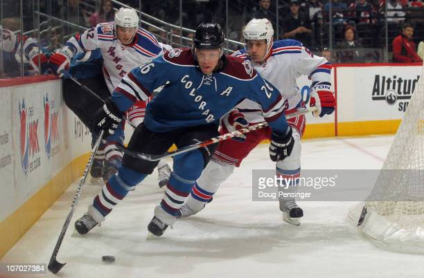 Paul Stastny of the Colorado Avalanche tries to control the puck as Dan Girardi of the New York Rangers is called for hooking at the Pepsi Center on...