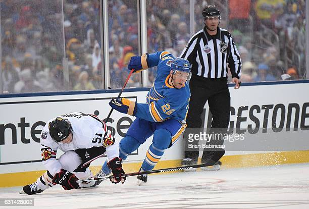 Paul Stastny of the St Louis Blues and Brian Campbell of the Chicago Blackhawks skate near the side boards during the 2017 Bridgestone NHL Winter...