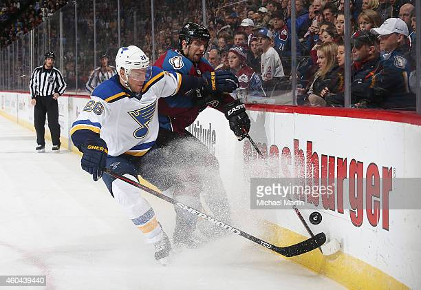 Paul Stastny of the St Louis Blues battles for the puck against Nate Guenin of the Colorado Avalanche at the Pepsi Center on December 13 2014 in...