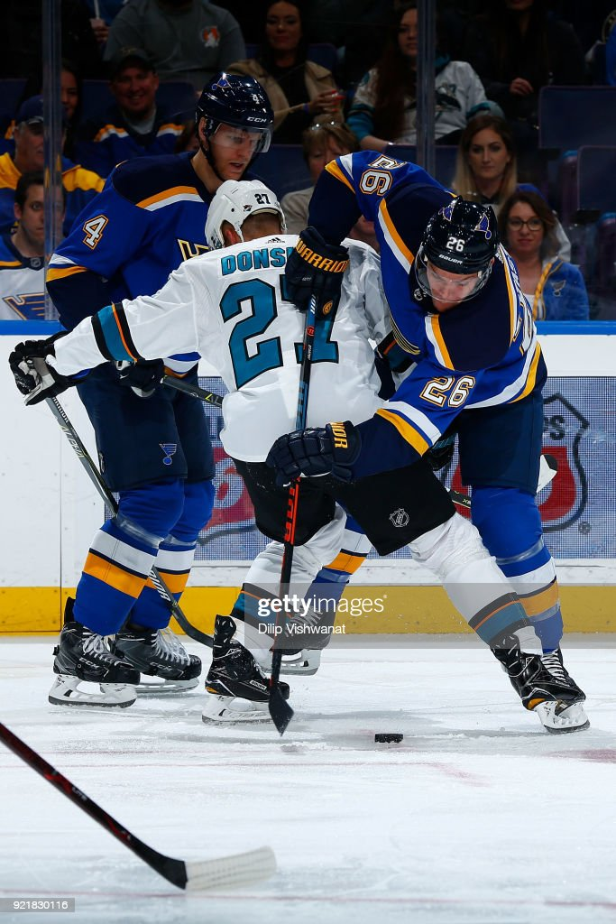 Paul Stastny #26 of the St. Louis Blues fights Joonas Donskoi #27 of the San Jose Sharks for the puck after a face off at Scottrade Center on February 20, 2018 in St. Louis, Missouri.