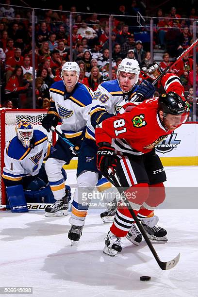 Paul Stastny of the St Louis Blues gets physical with Marian Hossa of the Chicago Blackhawks in the second period of the NHL game at the United...