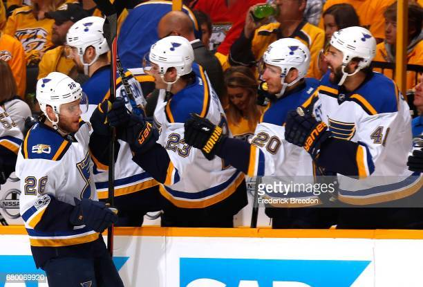 Paul Stastny of the St Louis Blues is congratulated by teammates Dmitrij Jaskin Alexander Steen and Robert Bortuzzo after scoring a goal against the...