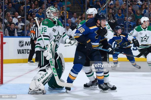 Paul Stastny of the St Louis Blues is defended against by Marc Methot of the Dallas Stars in front of Kari Lehtonen of the Dallas Stars on October 7...