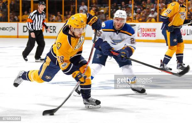 Paul Stastny of the St Louis Blues watches as Viktor Arvidsson of the Nashville Predators fires a shot during the first period of Game Four of the...