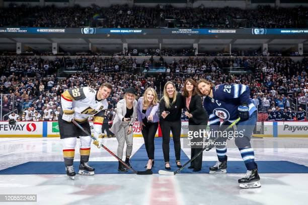 Paul Stastny of the Vegas Golden Knights and Blake Wheeler of the Winnipeg Jets pose for the ceremonial puck drop prior to NHL action on Hockey Is...