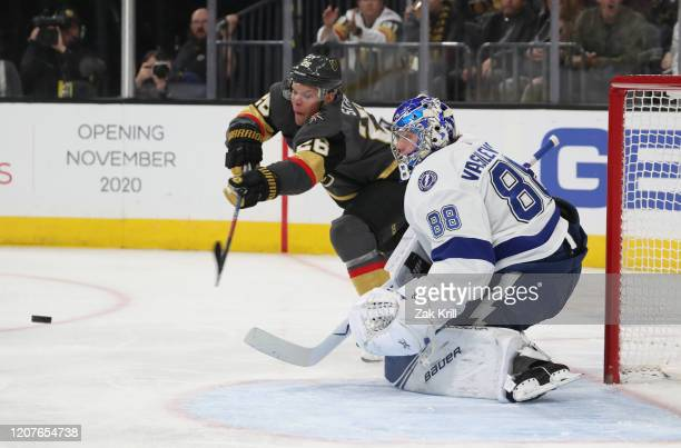 Paul Stastny of the Vegas Golden Knights attempts to deflect a shot on goal against Andrei Vasilevskiy of the Tampa Bay Lightning during the second...