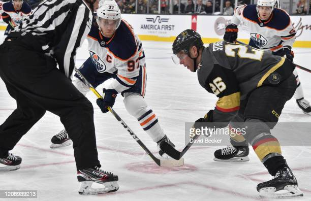 Paul Stastny of the Vegas Golden Knights face off with Connor McDavid of the Edmonton Oilers during the second period at TMobile Arena on February 26...